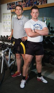 New heights: Pictured (left to right) are Ironman competitor Rhys Harries and power lifter Francis Barrett