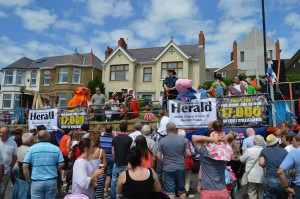 Clear message: 17000 readers on banners at Milford Carnival this year.