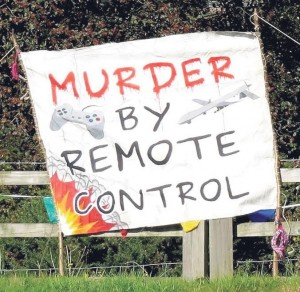 Projecting the message: One of many signs protesting against the use of drones