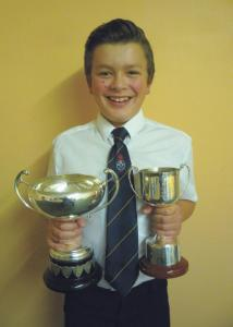 Young golfer: Abe with his two trophies.